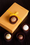 Chocolate handmade candies on a black table. Chocolate box royalty free stock photo