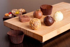 Chocolate handmade candies on a kitchen table. Horizontal Royalty Free Stock Image