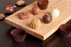Chocolate handmade candies on a kitchen table stock image