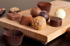 Chocolate handmade candies on a kitchen table stock images