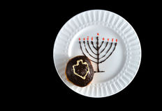 Chocolate hanukkiah with sufganiyah and sevivon Royalty Free Stock Photo