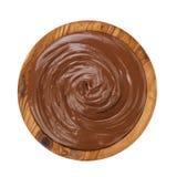 Chocolate hazelnut creamin wood bowl stock photography