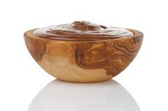 Chocolate hazelnut creamin wood bowl Stock Images