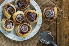 Chocolate hazelnut pinwheels dusted with icing sugar Stock Image