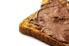 Chocolate hazelnut spread on whole wheat toast isolated Stock Photos