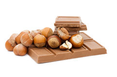 Chocolate and hazelnuts Stock Photos