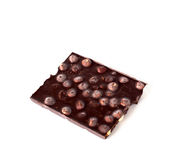 Chocolate with hazelnuts. On white background stock photo