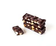 Chocolate with hazelnuts. On white background royalty free stock photo