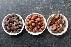 Chocolate, hazelnuts and cocoa beans Royalty Free Stock Photos