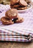 Chocolate and hazelnuts cookies  on cloth Stock Image