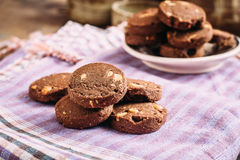 Chocolate and hazelnuts cookies  on cloth Stock Photo