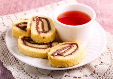 Chocolate, hazelnuts filling pinwheels. And cup of tea Royalty Free Stock Photography