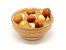 Chocolate with hazelnuts in glass bowl Royalty Free Stock Photo
