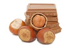 Chocolate and hazelnuts isloted over white Stock Photo
