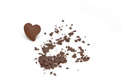 Chocolate heart. Chocolate chip cookie in a heart shape with chocolate shavings Stock Image