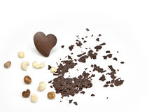 Chocolate heart. Chocolate chip cookie in a heart shape with chocolate chips and nuts Stock Photos