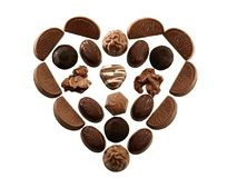 Chocolate Heart. A heart compiled of chocolate pralines, isolated Stock Images
