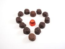 Chocolate heart. Chocolates in heart shape, with center wrapped piece stock images