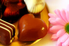 Chocolate heart. And pink flower Royalty Free Stock Image