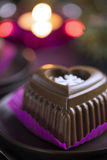 Chocolate Heart Cake with White Snowflake for New Years Eve Stock Photos