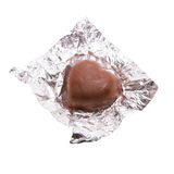 Chocolate heart candy in foil on white background.  Royalty Free Stock Photography