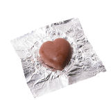 Chocolate heart candy in foil on white background.  Royalty Free Stock Photos