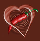 Chocolate heart and chili pepper Royalty Free Stock Images