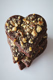 Chocolate heart cookies with crushed hazelnuts Royalty Free Stock Photography