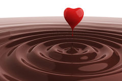 Chocolate heart in hot chocolate Stock Photos
