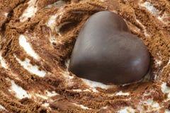 Chocolate heart on ice cream cake Royalty Free Stock Photo