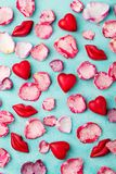 Chocolate heart and lips shaped candies with rose candied sugared petals. Blue background. Top view. Chocolate heart and lips shaped candies with rose candied royalty free stock image