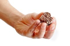 Chocolate heart on man's hand Stock Images