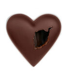 Chocolate heart pierced with a hole Royalty Free Stock Images