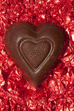 Chocolate Heart On Red Stock Image