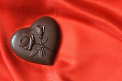 Chocolate Heart On Red Royalty Free Stock Image