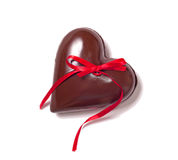 Chocolate heart and red riibbon Royalty Free Stock Photography