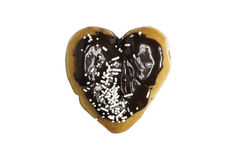 Chocolate heart shaped frosted donut. A chocolate frosted heart shaped donut with sprinkles  on a white background Royalty Free Stock Image