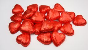 Chocolate hearts. Hearts from chocolate wrapped in red foil royalty free stock photography