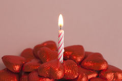 Chocolate hearts. Birthday candle and chocolate hearts Royalty Free Stock Image
