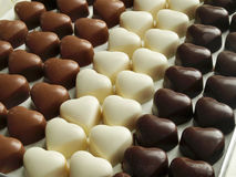 Chocolate hearts. Pure, milk and white chocolate hearts Stock Images