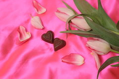 Chocolate hearts. Candy and flowers Stock Photography