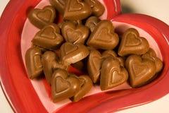 Chocolate Hearts. A valentines heart dish full of chocolate hearts royalty free stock photos