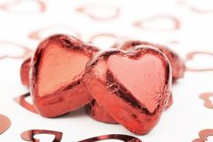 Chocolate hearts. Red foil covered chocolate hearts Stock Images