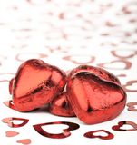 Chocolate hearts. Red foil covered chocolate hearts Royalty Free Stock Photos