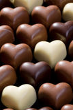 Chocolate hearts background Stock Images
