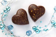Chocolate Hearts With Blue Beads Stock Images