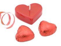 Chocolate hearts, candle and ribbon Stock Photography