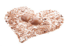 Chocolate hearts and chips on white background. Chocolate hearts and chips on a white background Royalty Free Stock Photo