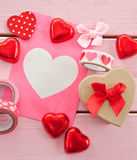 Chocolate hearts and colorful gift bag Royalty Free Stock Photo