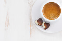 Chocolate hearts and espresso on white background, top view Stock Images